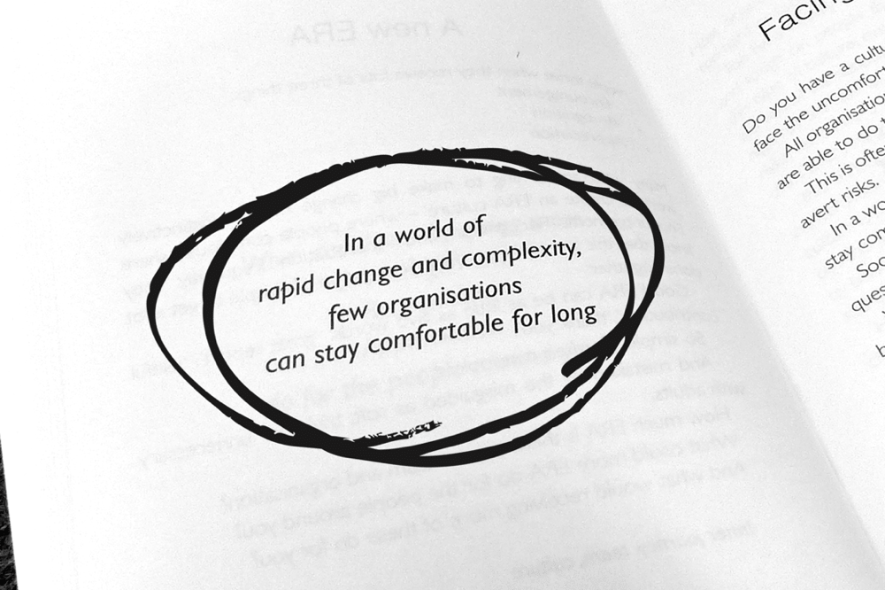 Circled book quote - In a world of rapid change and complexity, few organisations can stay comfortable for long